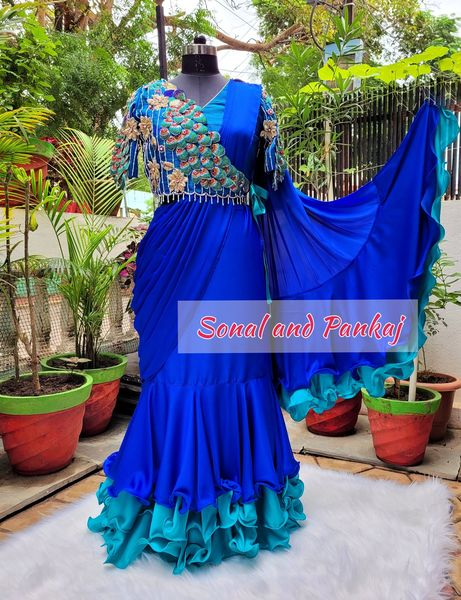Ready-to-Wear indulgence.. Season of Blue.. 3D Peacock hand embroidered jacket style blouse with ready to wear layered ruffle saree.. On pre-orders (delivery time 7-8 weeks) 2021-09-23