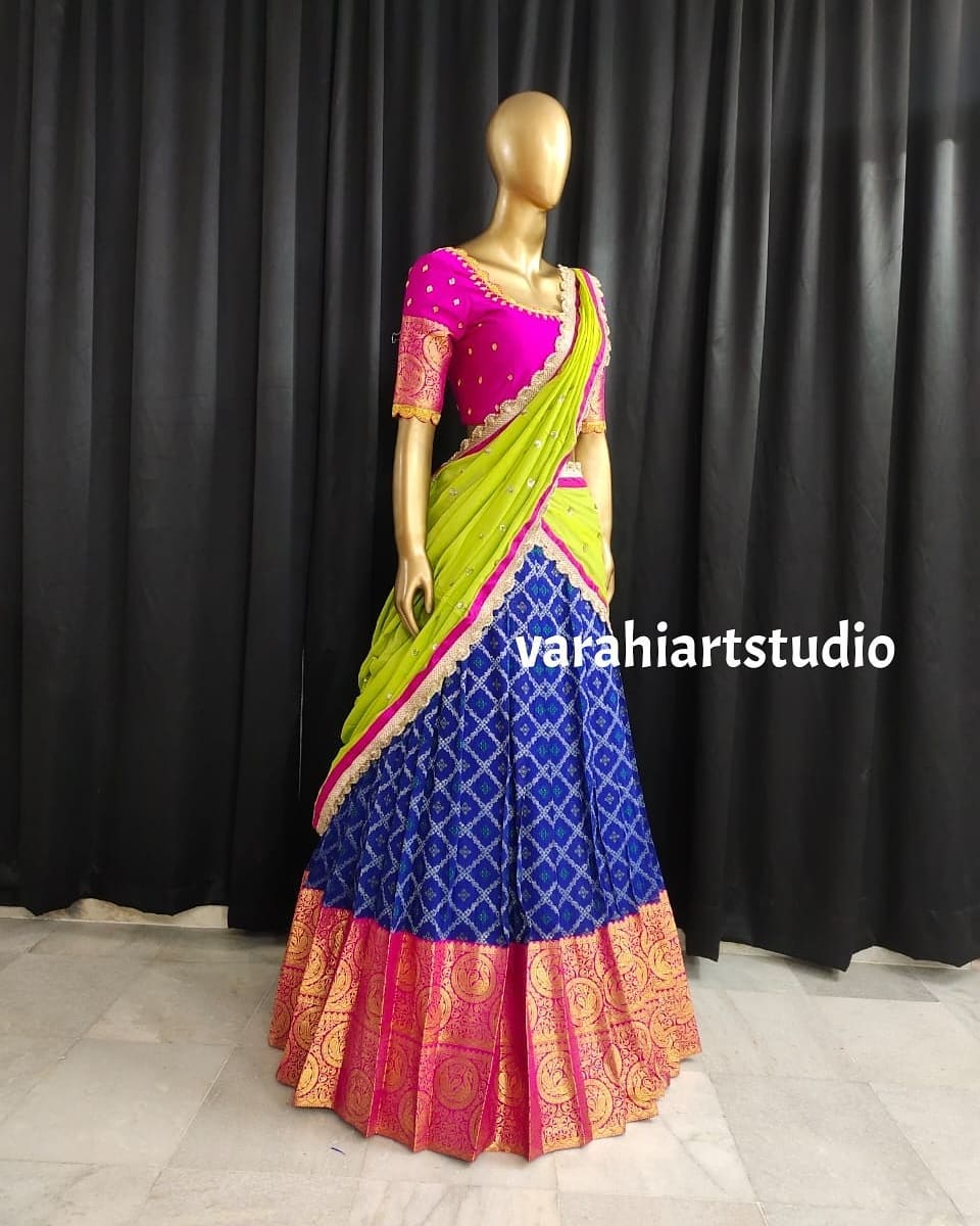 Stunning blue pattu lehenga and pink blouse with parrot green net dupatta. Blouse with hand embroidery maggam work.  2021-09-23