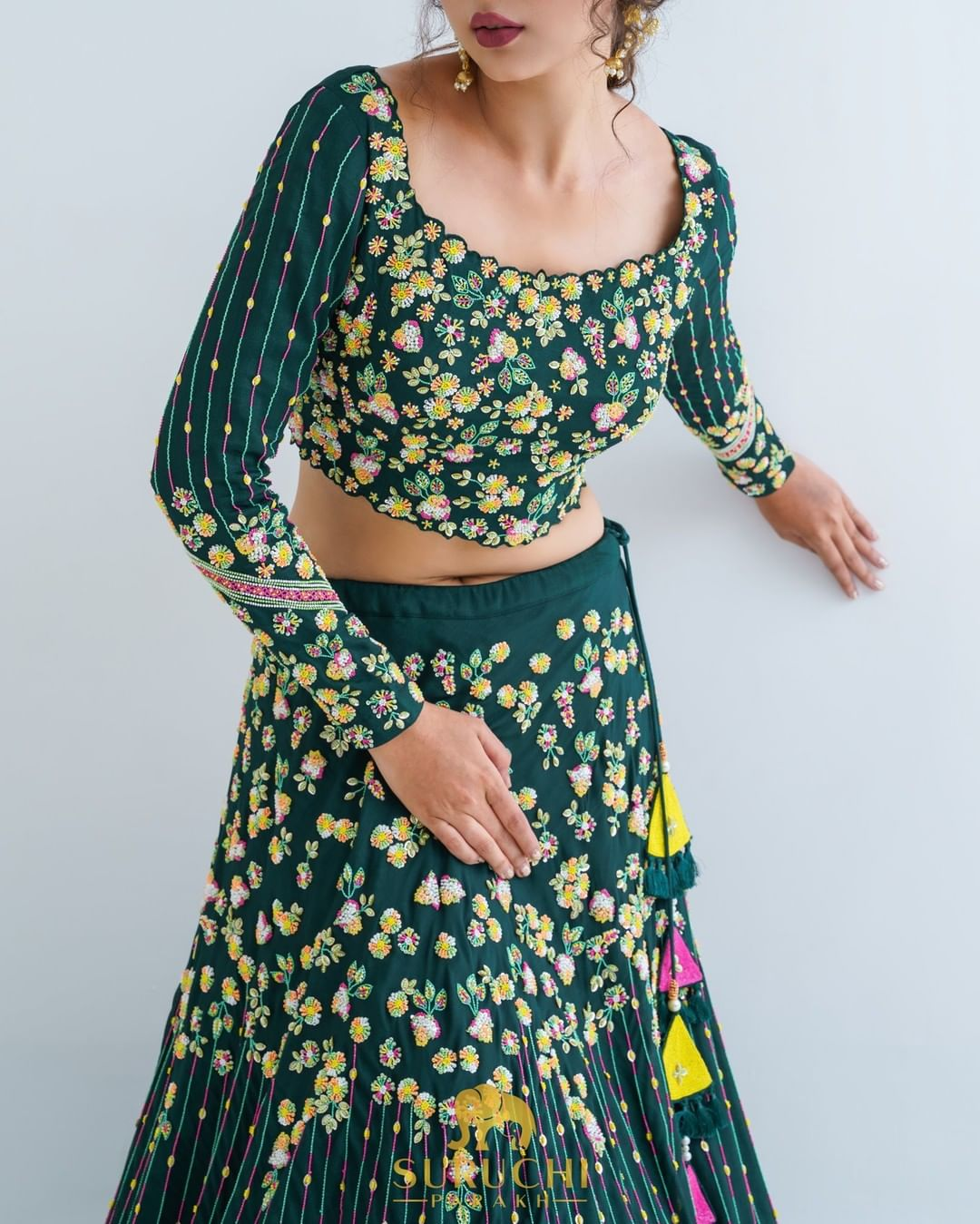 Stunning bottle green bridal lehenga and blouse with classy floral hand embroidery multi color thread work.  2021-09-23