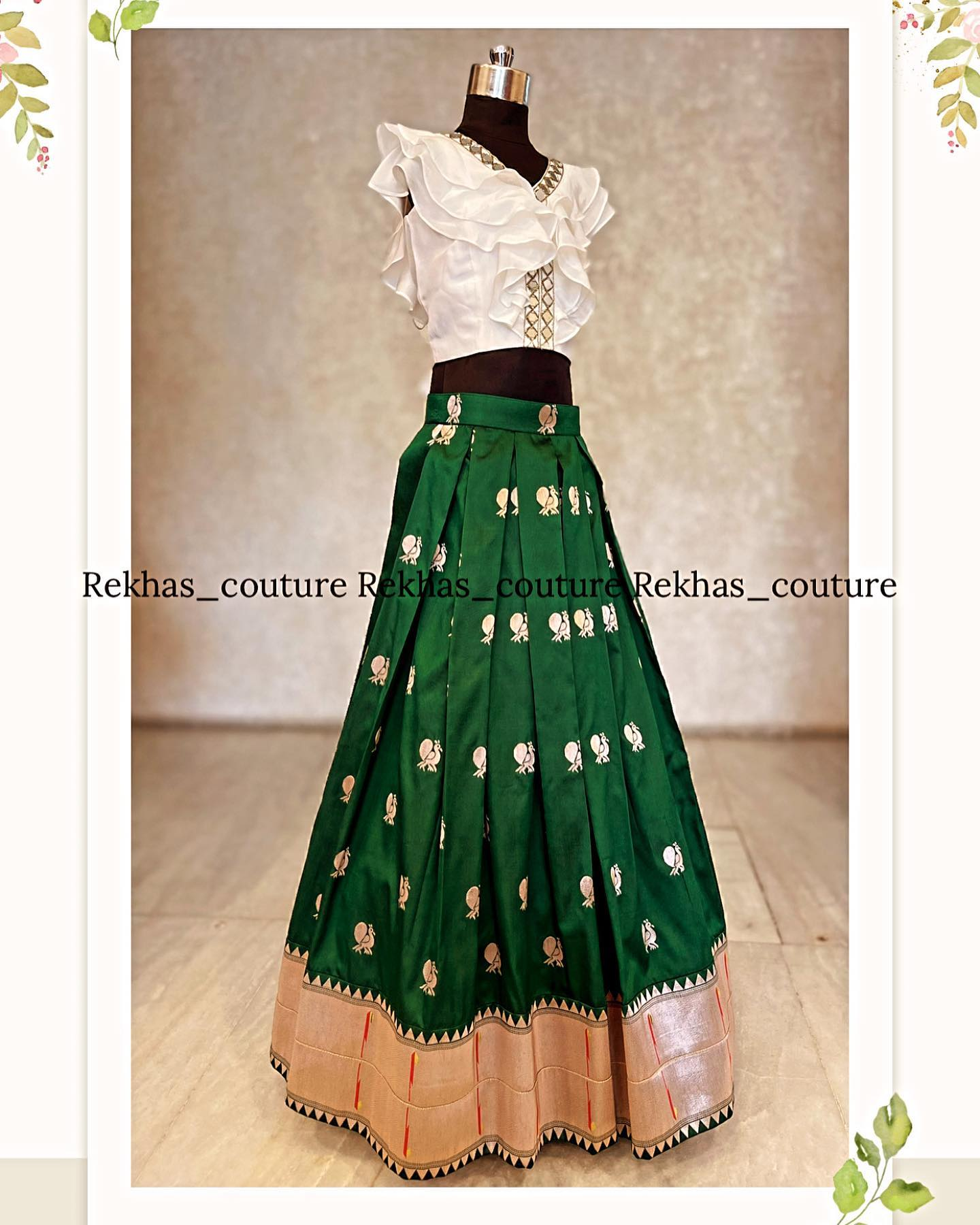 Stunning bottle green color pattu skirt and ruffle crop top with mirror work. 2021-09-24