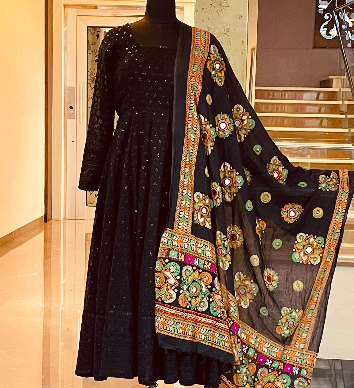 Beautiful black color Georgette chickenkari long frock paired with mirror Kutch work Duppatta.  2021-09-24