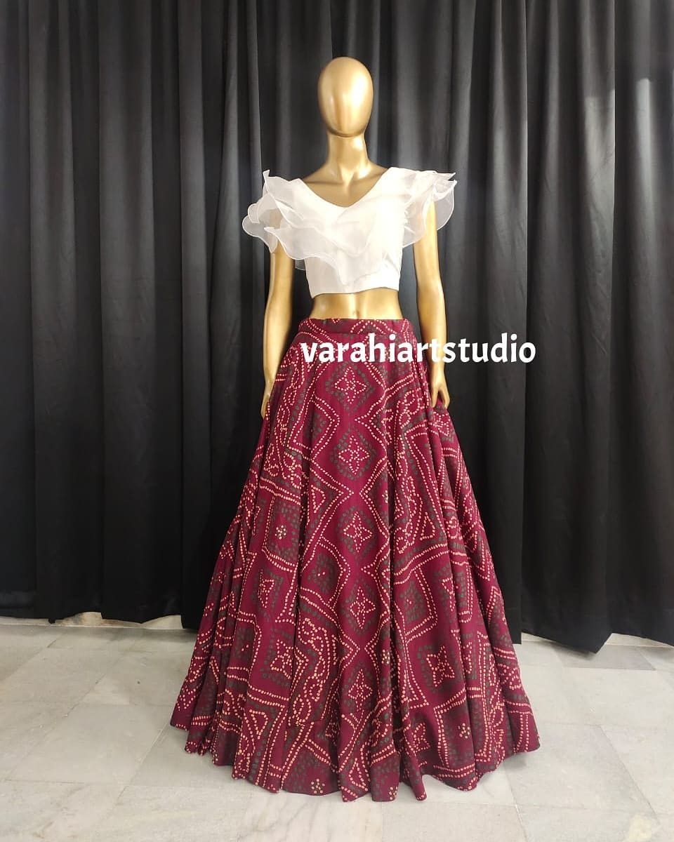 Lovely brown color bandhini skirt and white color ruffle crop top. 2021-09-24