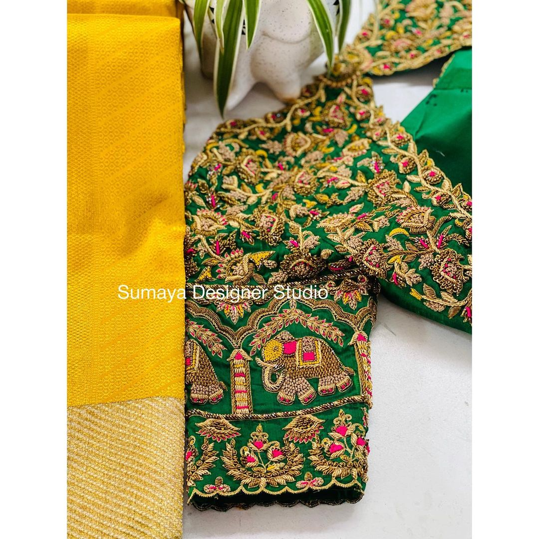 Gorgeous green bridal blouse with floral creeper and elephant hand embroidery   gold tread maggam work. 2021-09-24