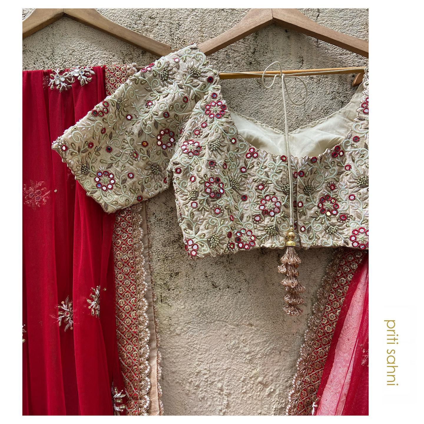 Shining in its glory auspicious red and serene ivory thread and mirror work blouse. 2021-09-25