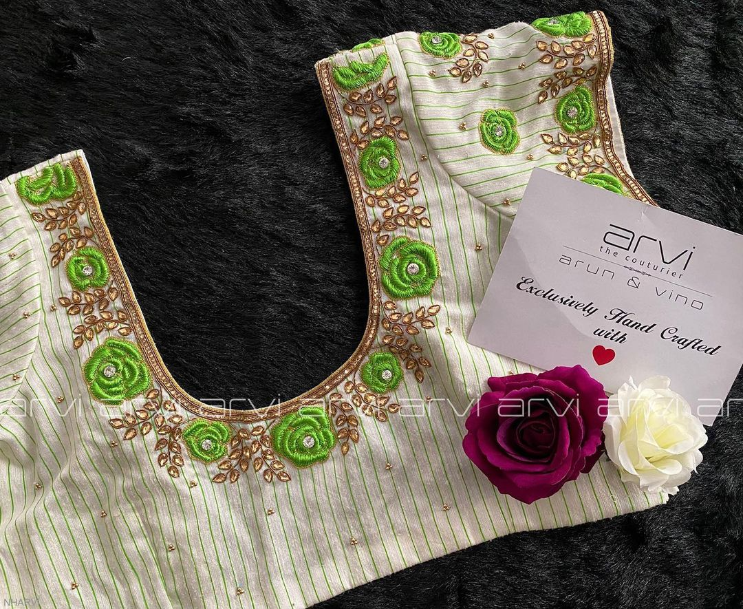 Gorgeous off white color bridal blouse with rose floral and creeper hand embroidery thread and kundan maggam work.  2021-09-25