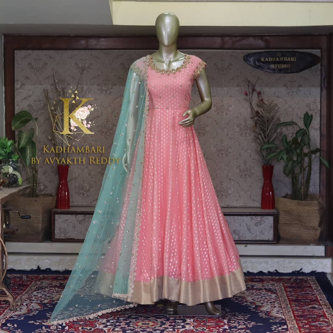 Beautiful blush pink color benarasi floor length anarkali with sea green net duaptta. This outfit is Available@8500/- 2021-09-25