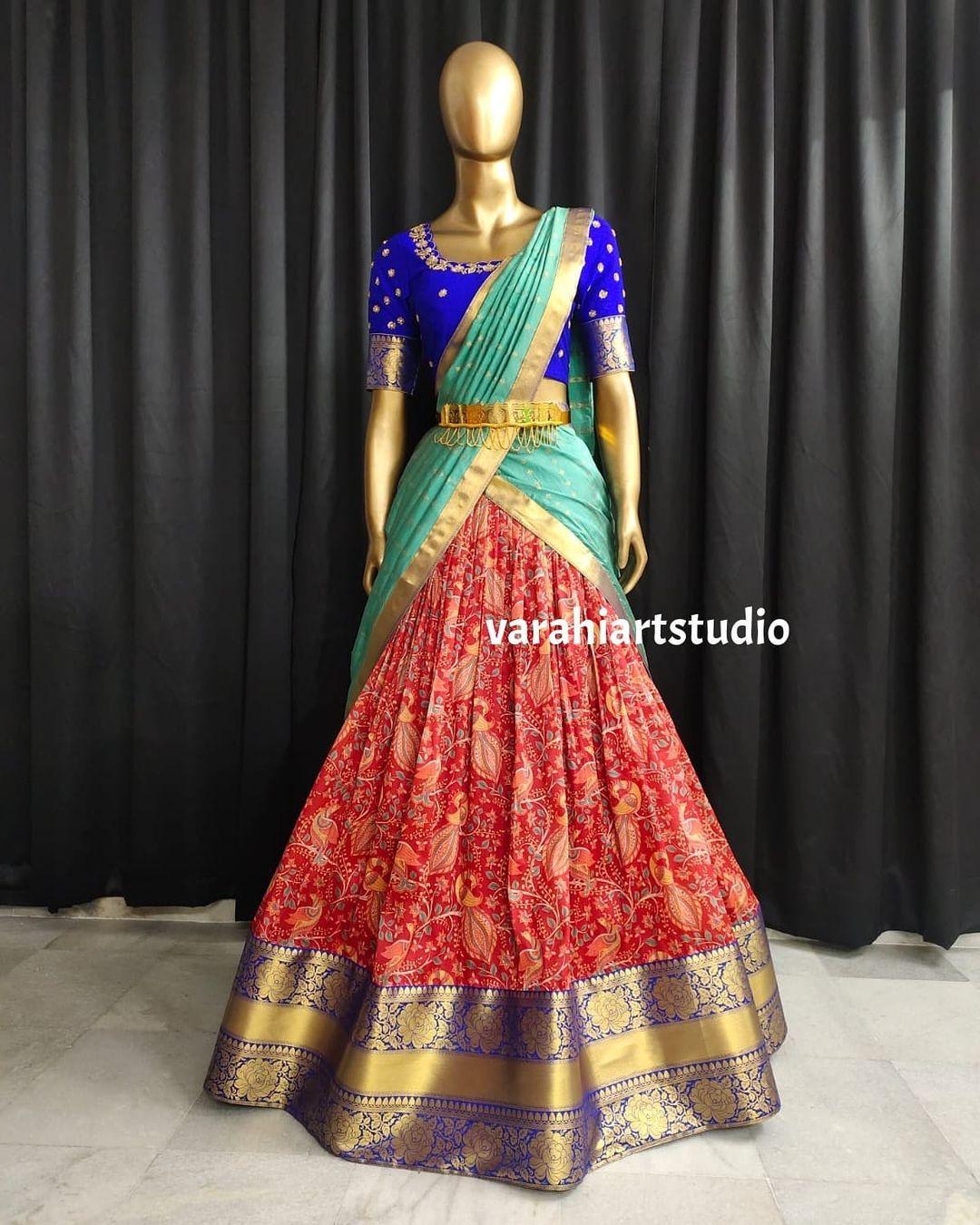 Beautiful red color pattu lehenga and royal blue blouse with net dupatta.  2021-09-25