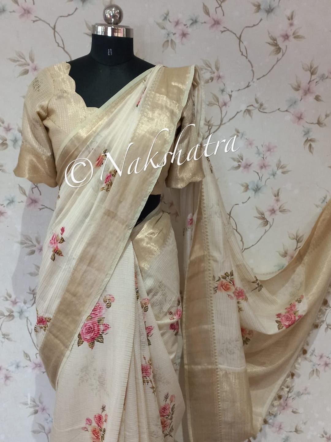 Beautiful and elegant floral soft and falling cotton blend  banarasi saree with beautiful zari border and pallu   It had striped stitch pattern allover the saree paired with scalloped hemlined neck blouse. 2021-09-26