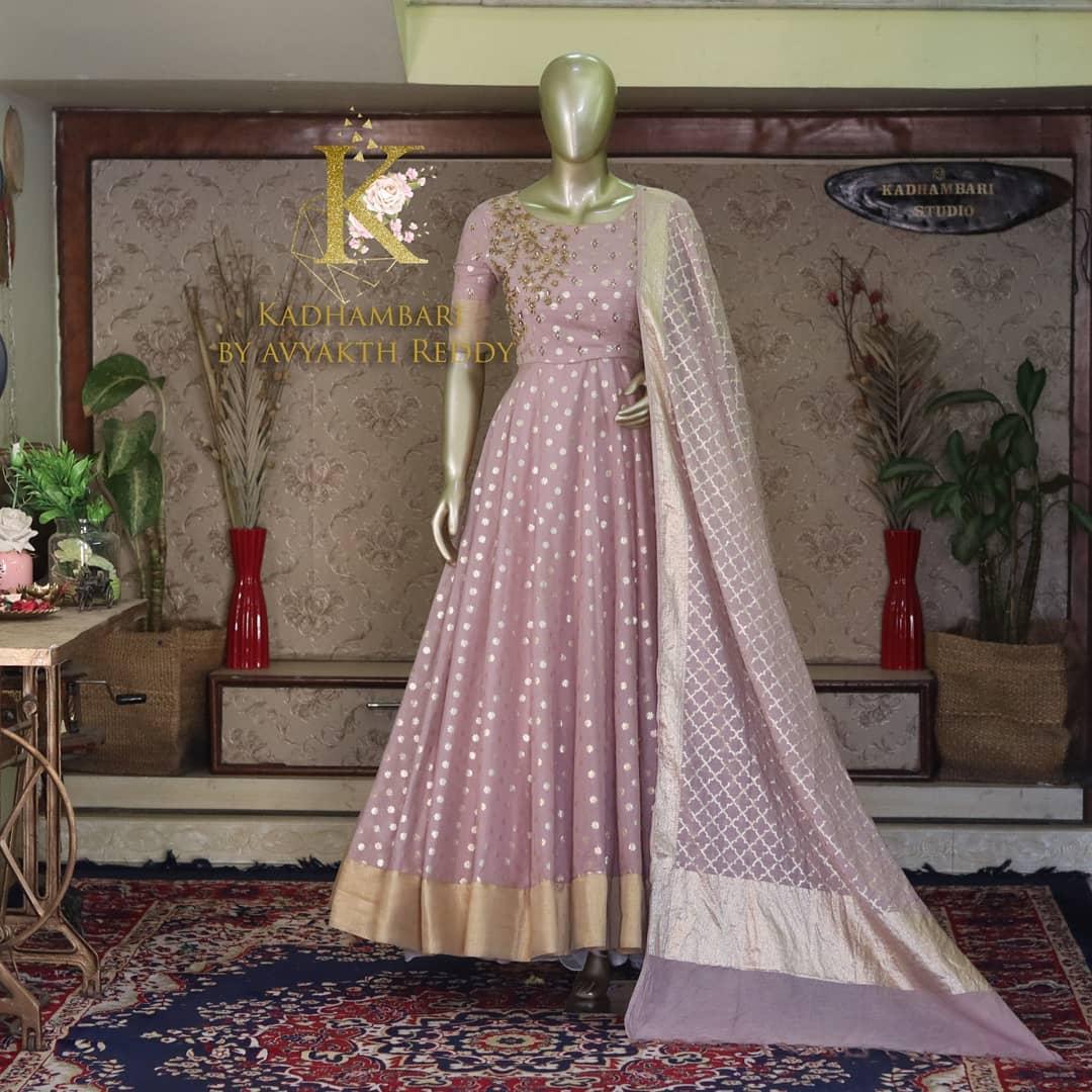 Gorgeous lavender benarasi pattu long frock with net dupatta. Long frock with hand embroidery work on yoke.  2021-09-26
