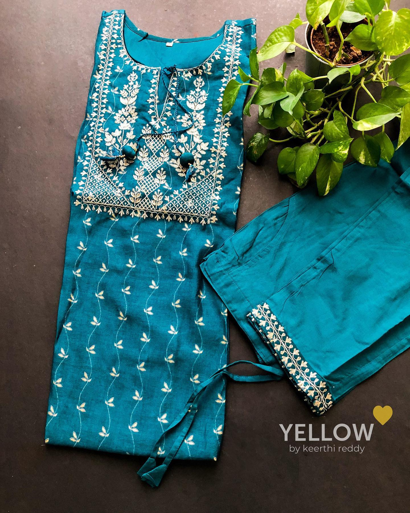 Teal blue cotton printed kurti with flat zari embroidery paired up with delicate worked straight pants. Size - M  L  XL  XXL Price - 2899 INR  2021-09-26