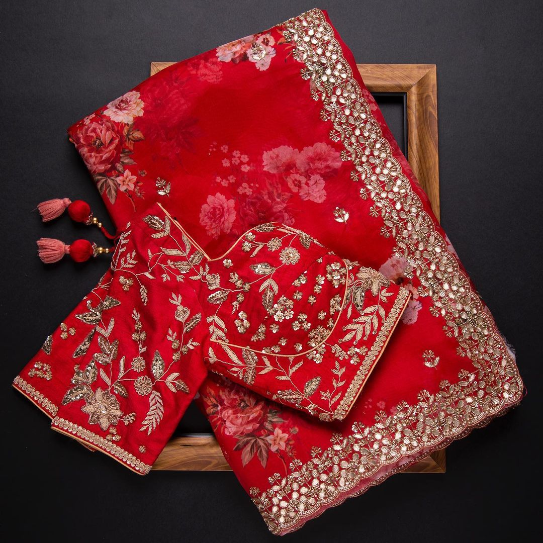 For your vivacious ethnic personality bring you this striking Red floral organza drape saree with gota enriched borders is paired with a densely embroidered ready blouse is class apart. 2021-09-26