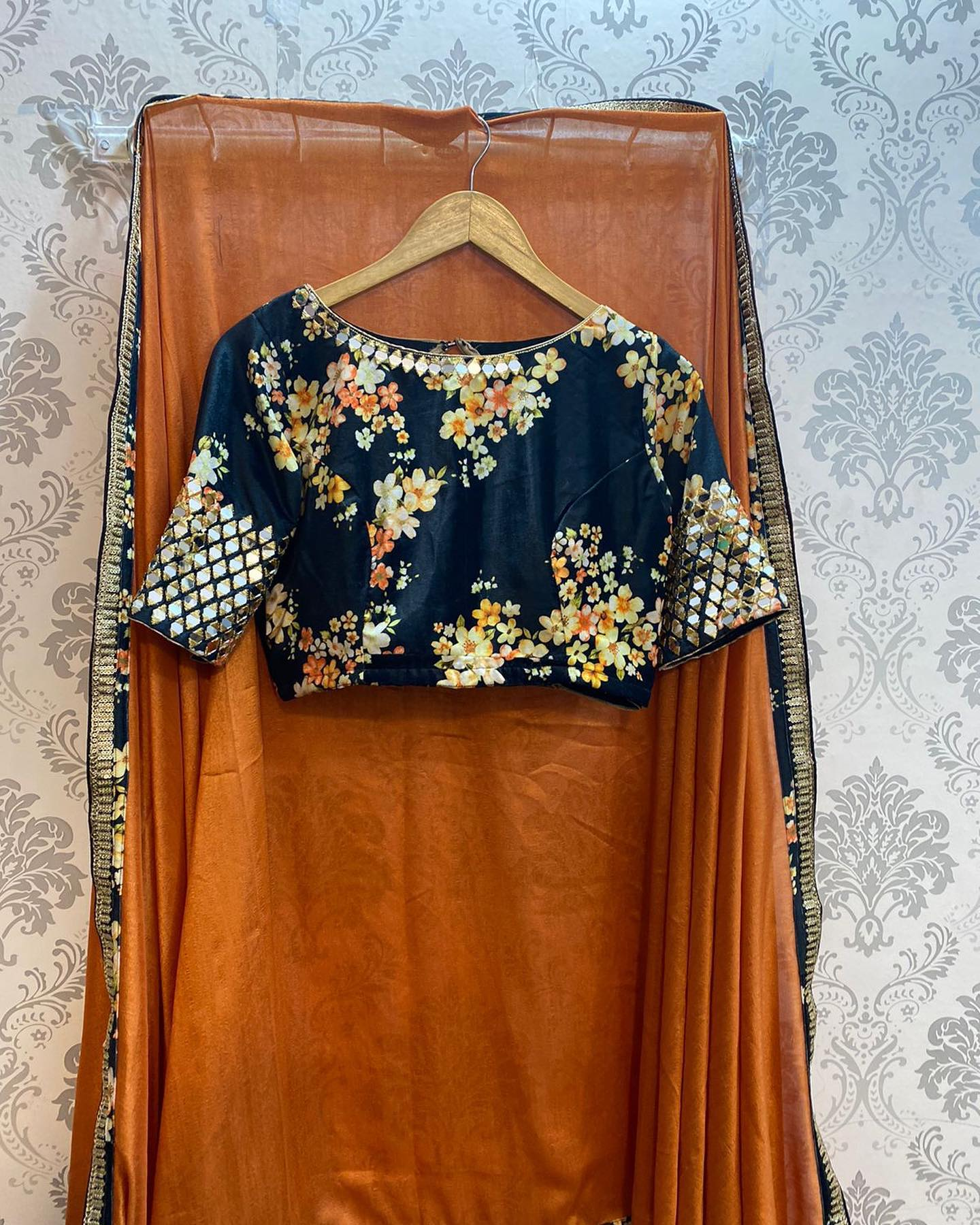 Feel festive with this original mirror worked floral velvet blouse and light brown silk saree with waist belt ..!!  For orders watsapp on 8072774265 Mail  on orders@threadslabel.com. 2021-09-27