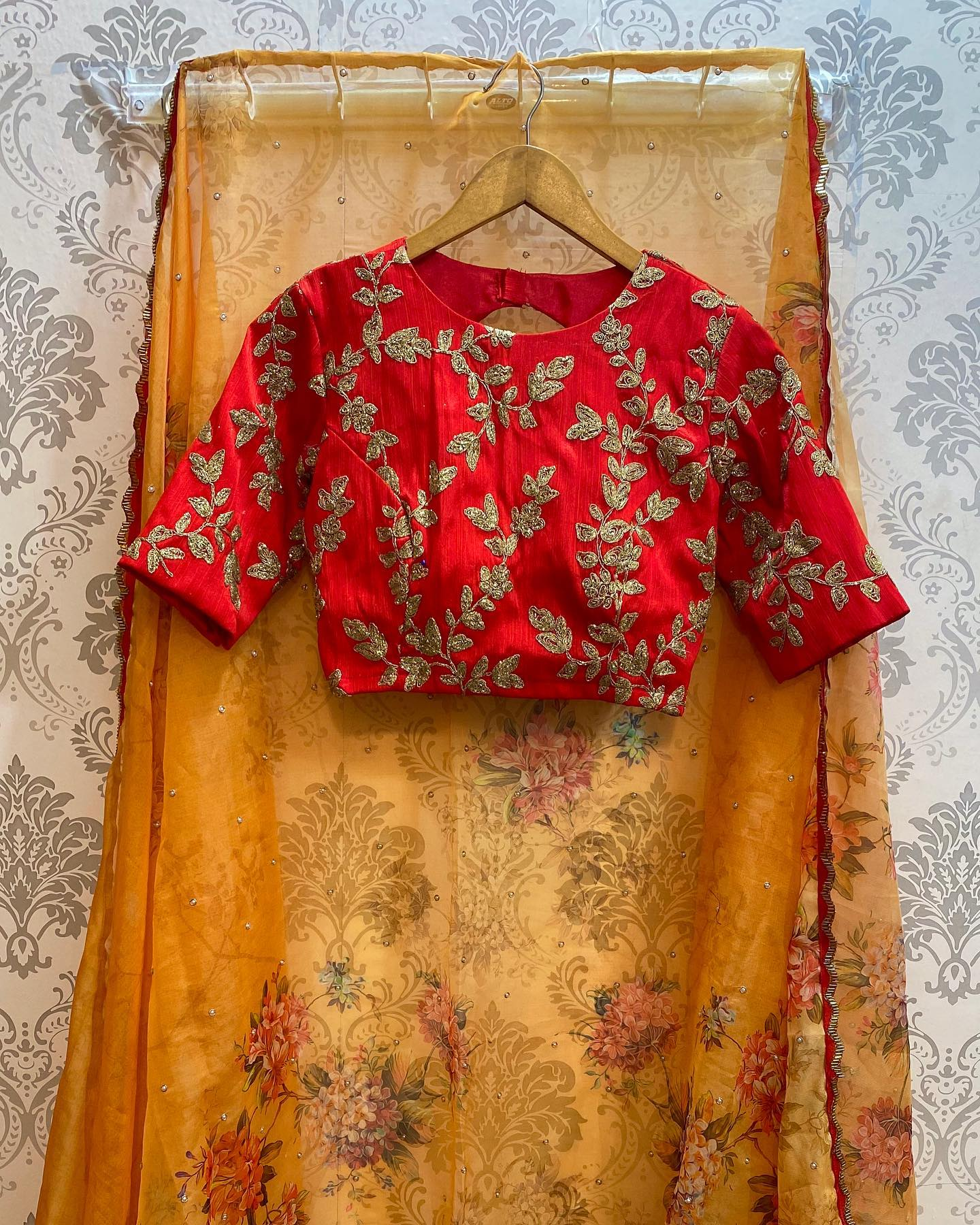 Red and yellow floral saree with full pearl handwork all over the saree comes with red silk embroidery blouse ..!!  For orders watsapp on 8072774265. 2021-09-27