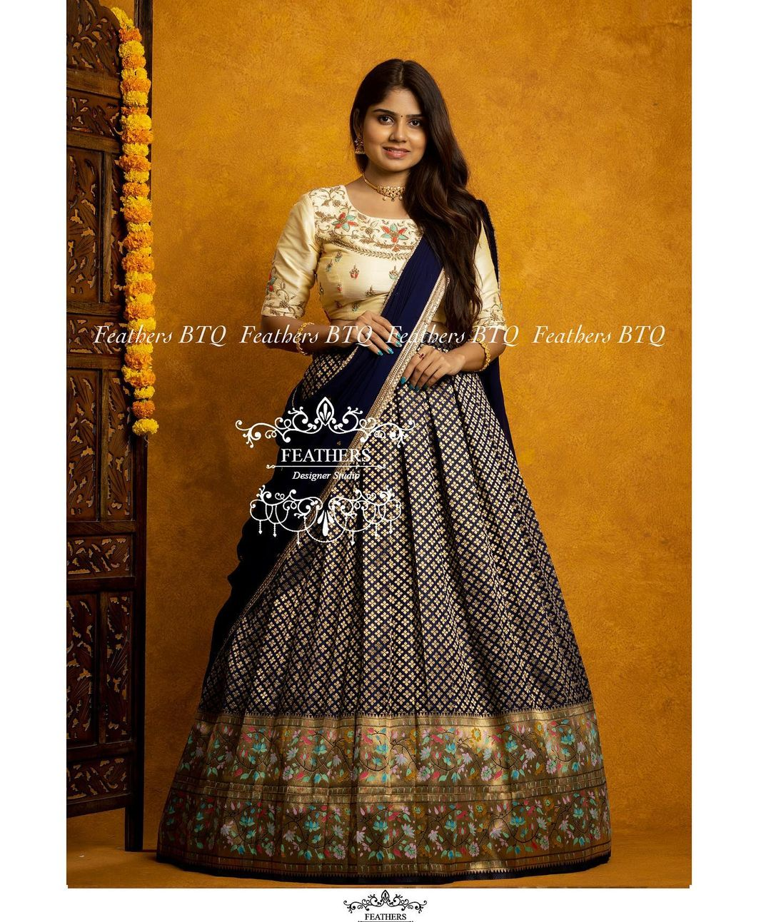 Stunning deep blue color pattu lehenga and off white color blouse with net dupatta. 2021-09-27