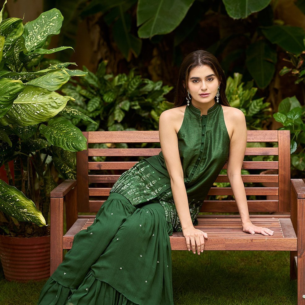Zara in Pine Needle Green sharara set accented with silver zardozi floral embroidery on kurta and minute details on sharara.  To shop new collection Phulwari DM  or Whatsapp  on +91 99083 48333. 2021-09-28