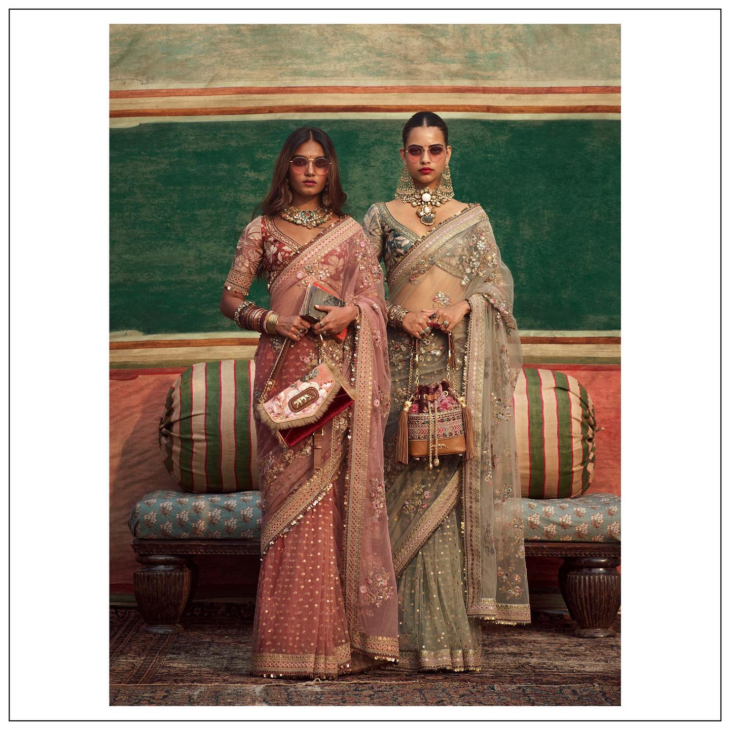 Beautiful wine and olive green color organza saree form Sabyasachi. The Sabyasachi 2021 Collection.   For all product related queries please email at customerservice@sabyasachi.com 2021-09-29