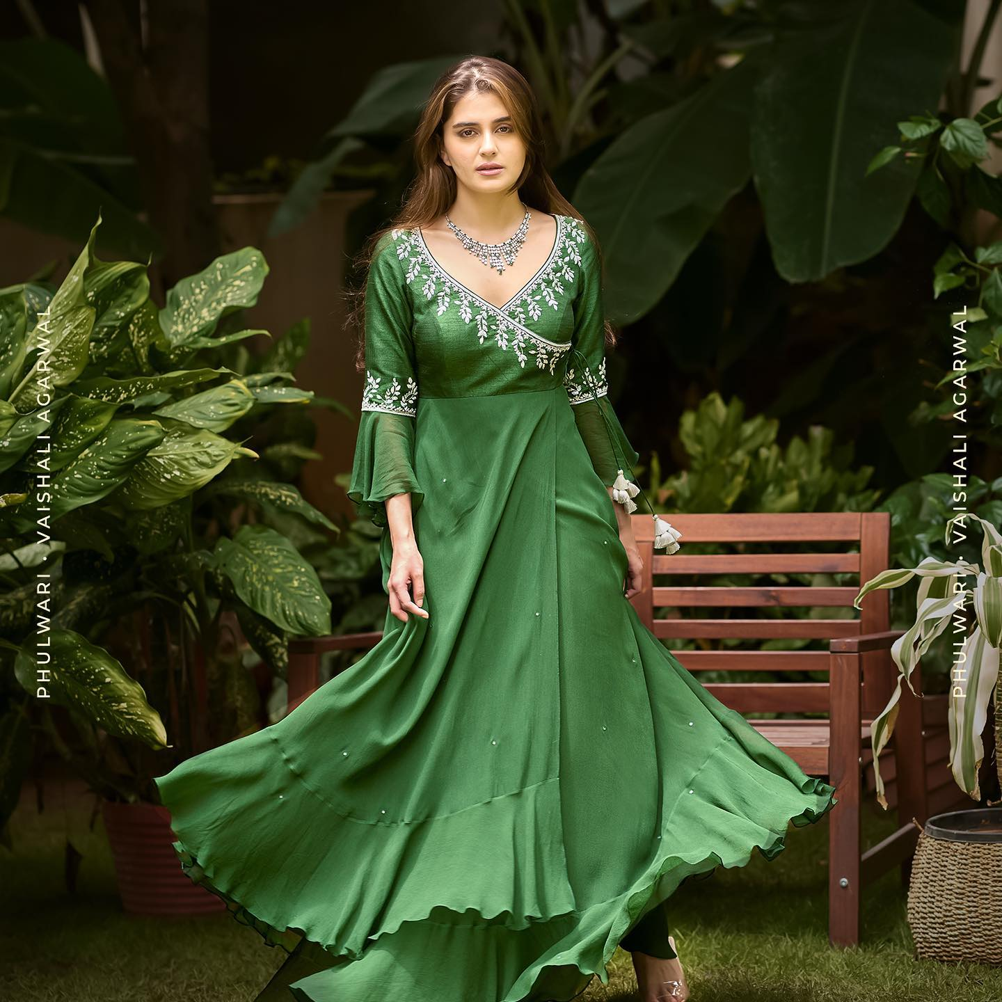 Phulwari. Zara in Pine Needle Green wrap style anarkali and pants with silver zardozi detailing on the neckline with ruffled sleeves detailing and uneven hem. To shop our new collection Phulwari DM or Whatsapp us on +91 99083 48333. 2021-09-30