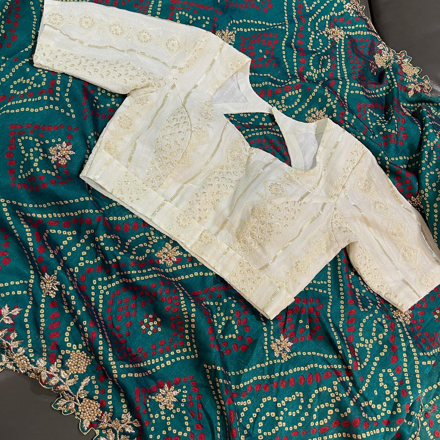 Beautiful bandhini saree with pearl white embroidery blouse. Price : 5000 INR. 2021-09-30