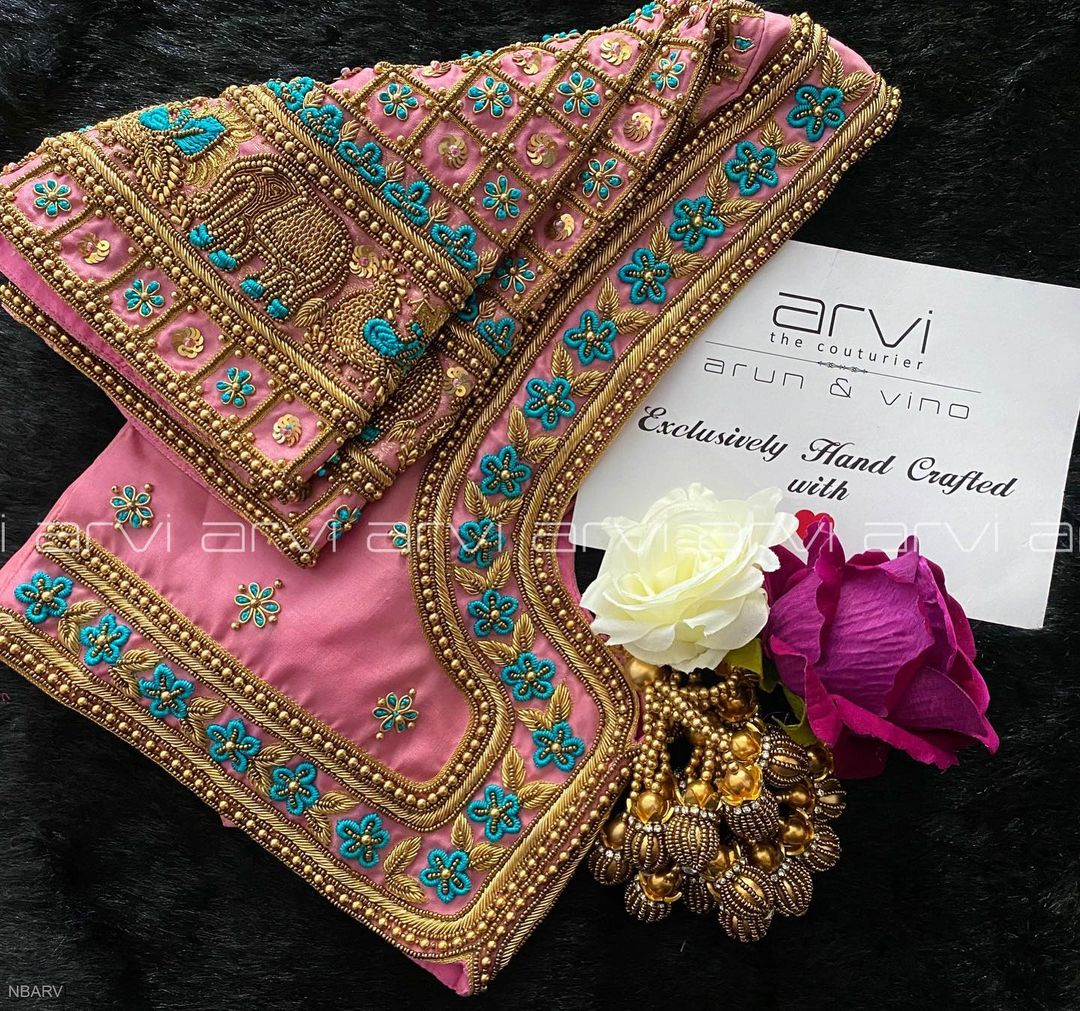 Gorgeous blush pink color bridal blouse with floral and elephant hand embroidery bead and gold thread maggam work. 2021-09-30