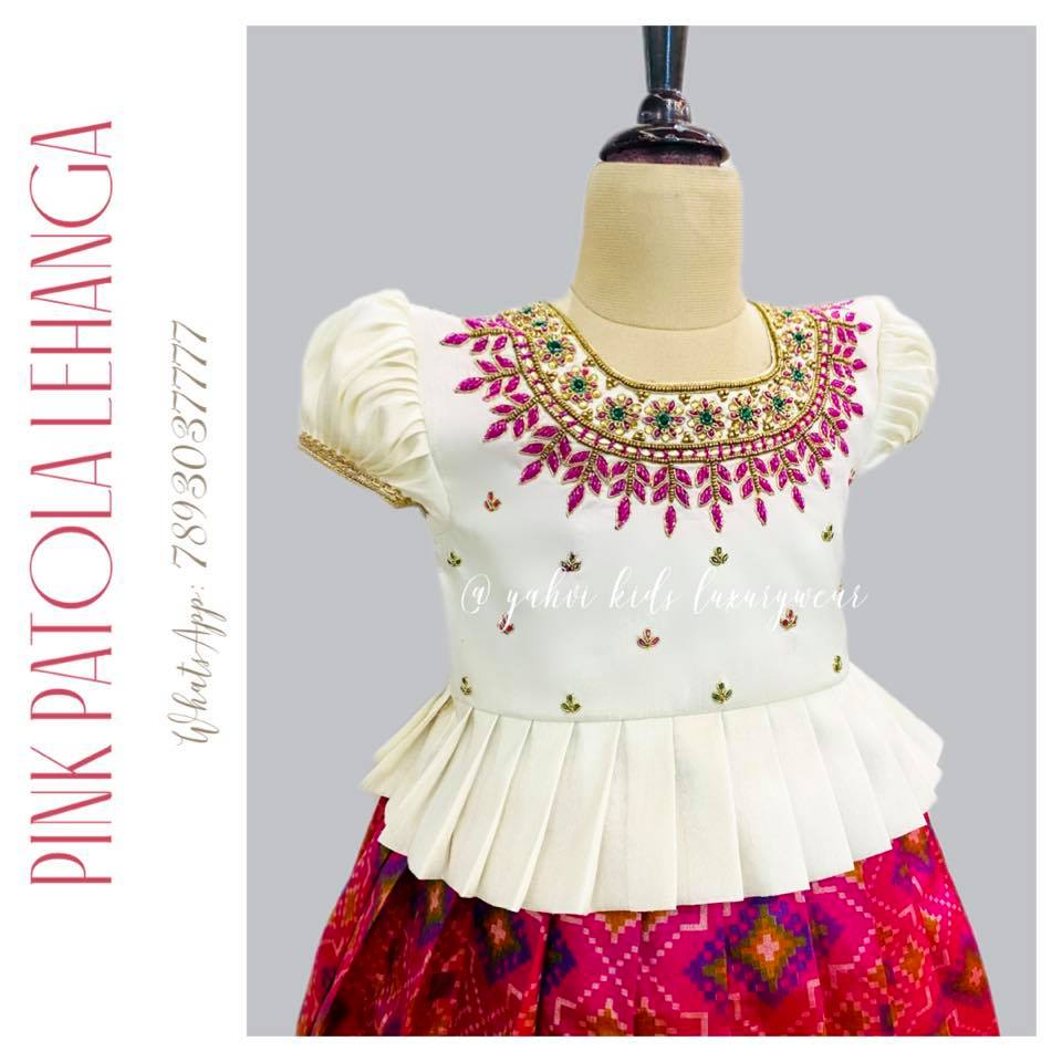 """"""" PATOLA kids LEHANGA"""" silk lehanga paired with white pleated blouse in beautiful embroidery work . Limited edition grab soon"""