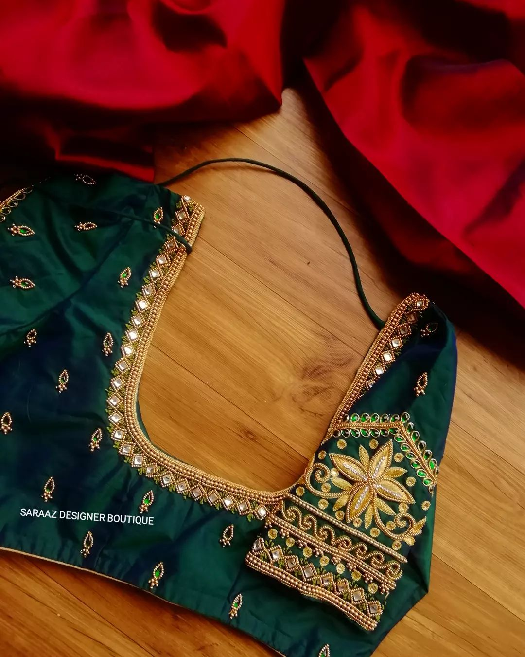 Gorgeous Emerald green color bridal blouse with bead gold thread and kundan maggam work. 2021-10-01