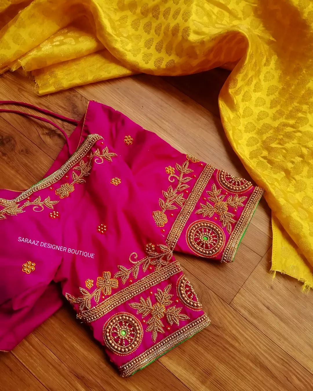 Stunning pink color bridal blouse with floral and creeper hand embroidery bead aari work.  2021-10-01