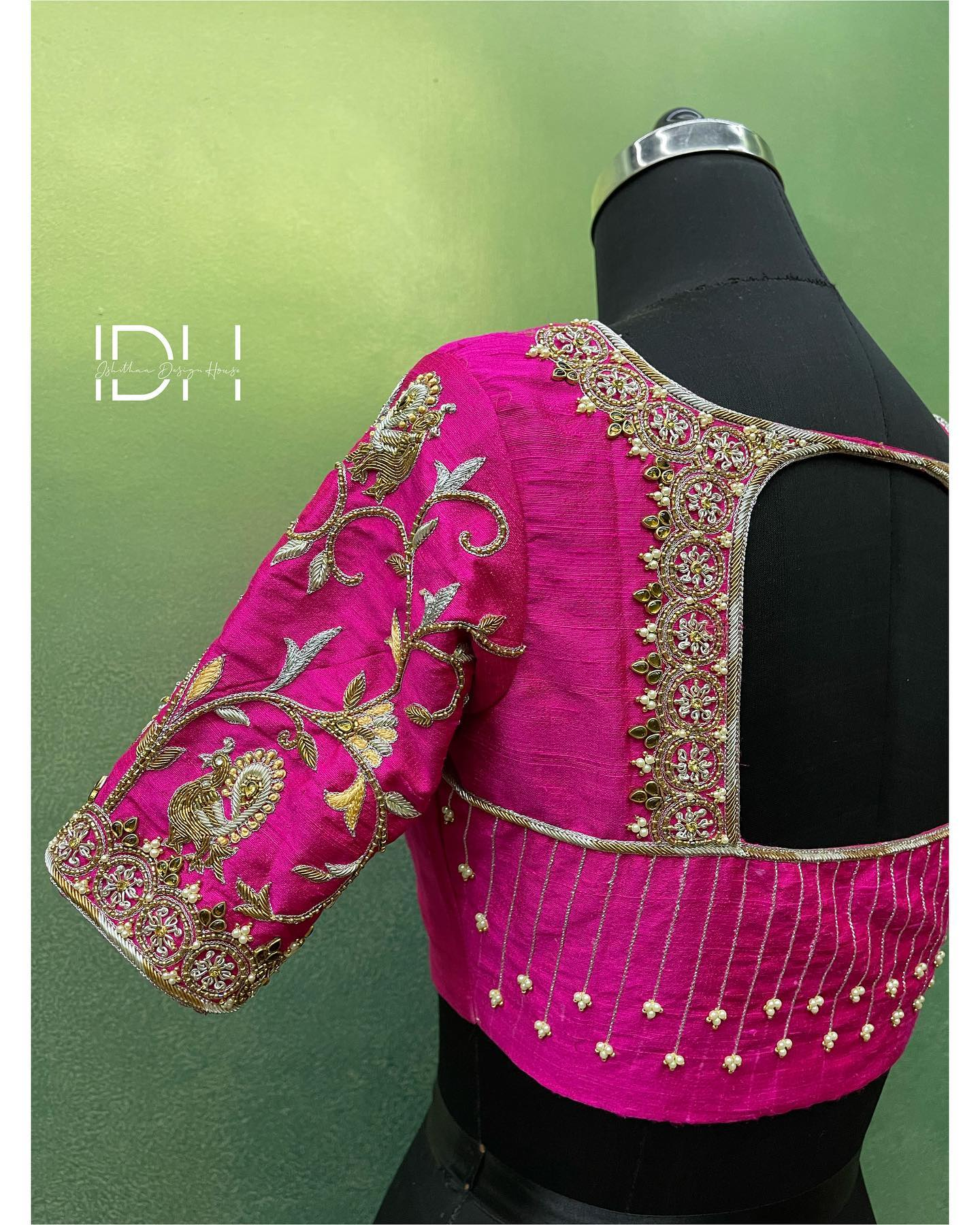 Gorgeous pink color bridal blouse with floral swans and creeper hand embroidery zardosi work.  2021-10-02