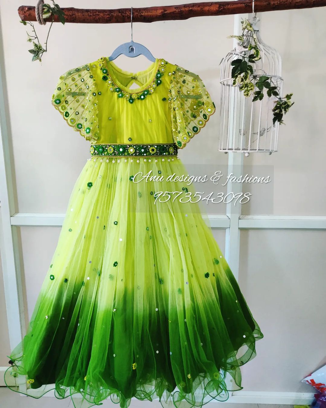 Stunning pista green and leaf green color combination kids frock with ruffle sleeves. Kids frock with bead and mirror hand embroidery work.  2021-10-02