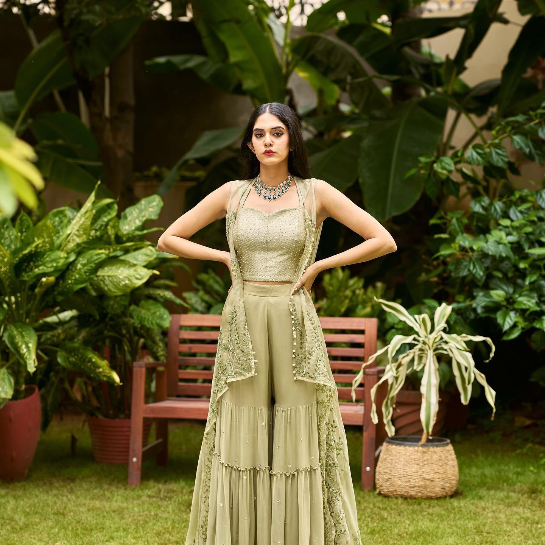 Phulwari . Kritya in Rosemary Green sharara set. It has an embellished crop top and sharara with an elegantly embroidered sheer organza jacket.  To shop new collection Phulwari DM or Whatsapp us on +91 99083 48333… 2021-10-03