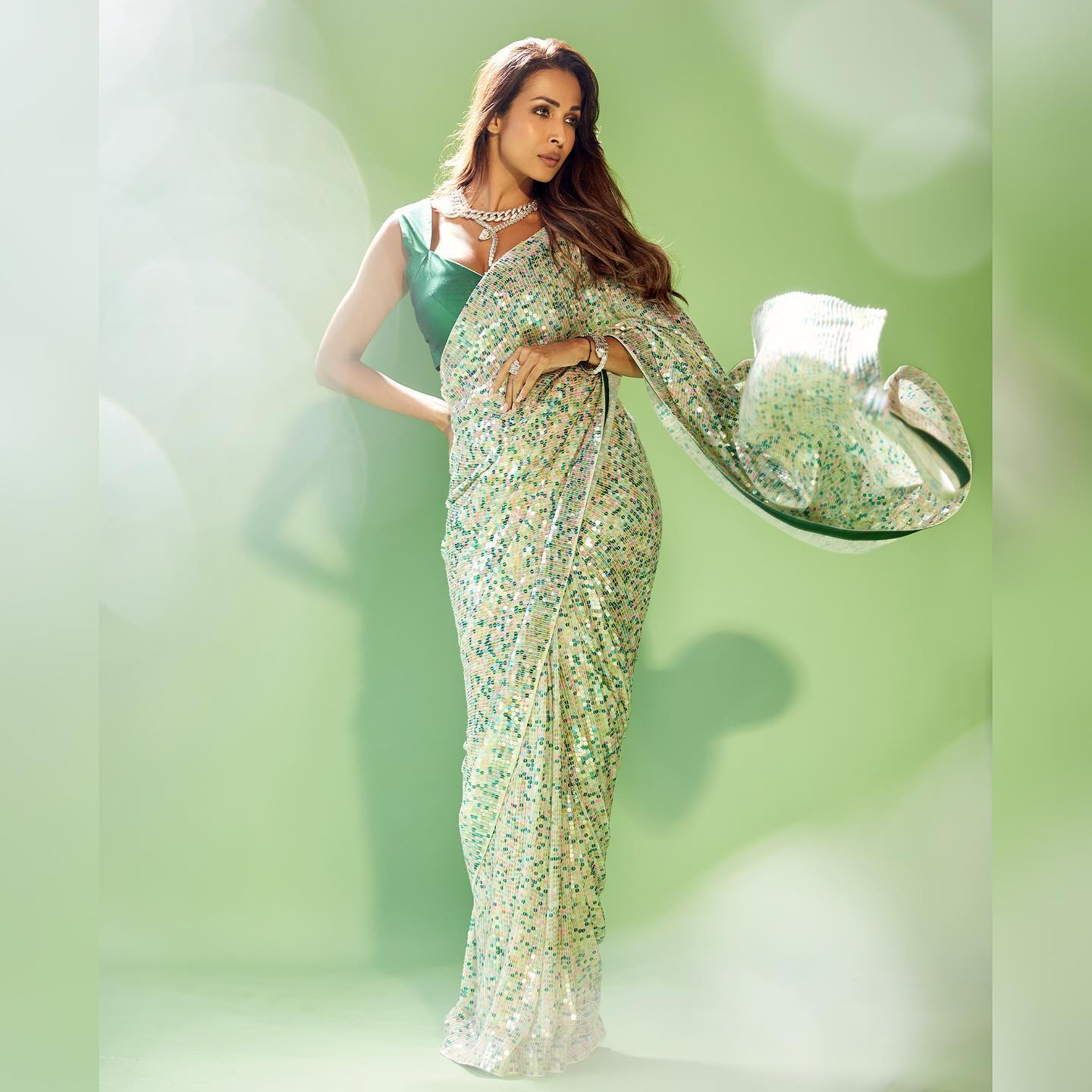 An exquisite My mm saree classic that soars with vivid craftsmanship  the spectacular Malaika Arora glistens in the glamour of green apple. Muse: Malaika Arora.  Outfit: Manish Malhotra. 2021-10-03