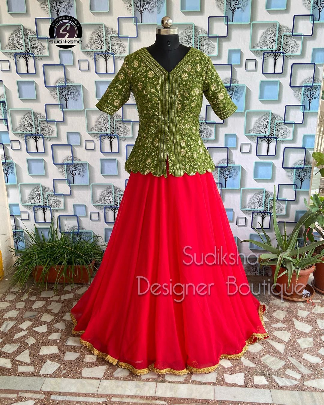 Gorgeous red net skirt and pine green color peplum top with hand embroidery work.  2021-10-03