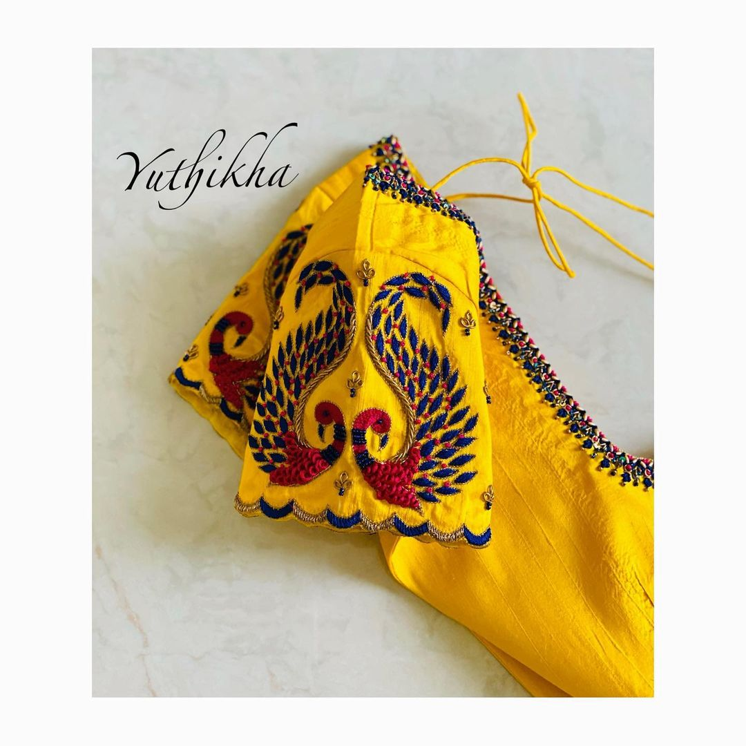 Peacock Sleeve embroidery. Stunning yellow color bridal blouse sleeve with peacock thread maggam work. 2021-10-03