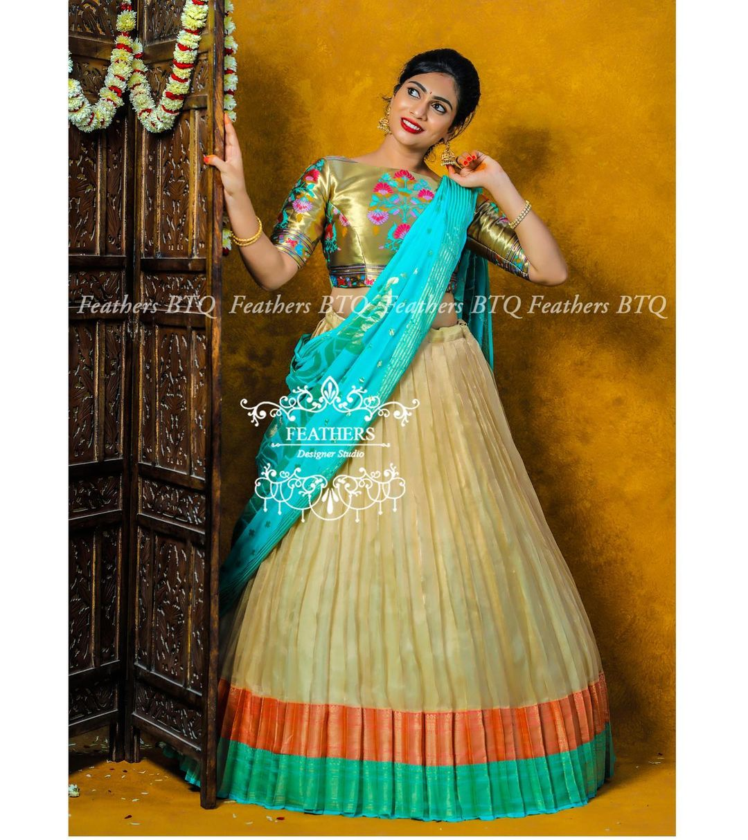 Gorgeous off white color benarasi lehenga and high neck blouse with teal blue color dupatta. 2021-10-03