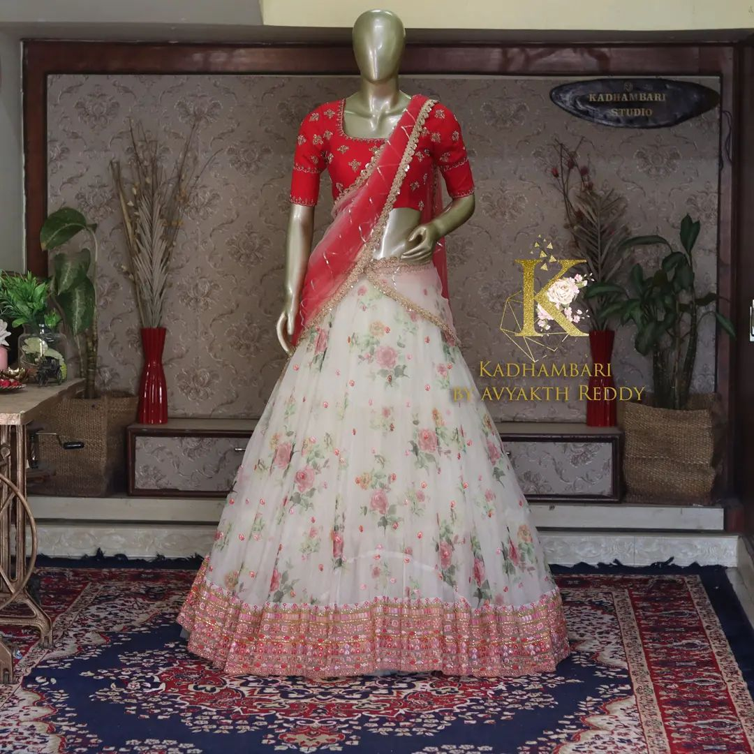 Gorgeous pearl white color floral lehenga and red blouse with net dupatta. Blouse with aari work. This outfit is Available @ price : 13800/- 2021-10-03