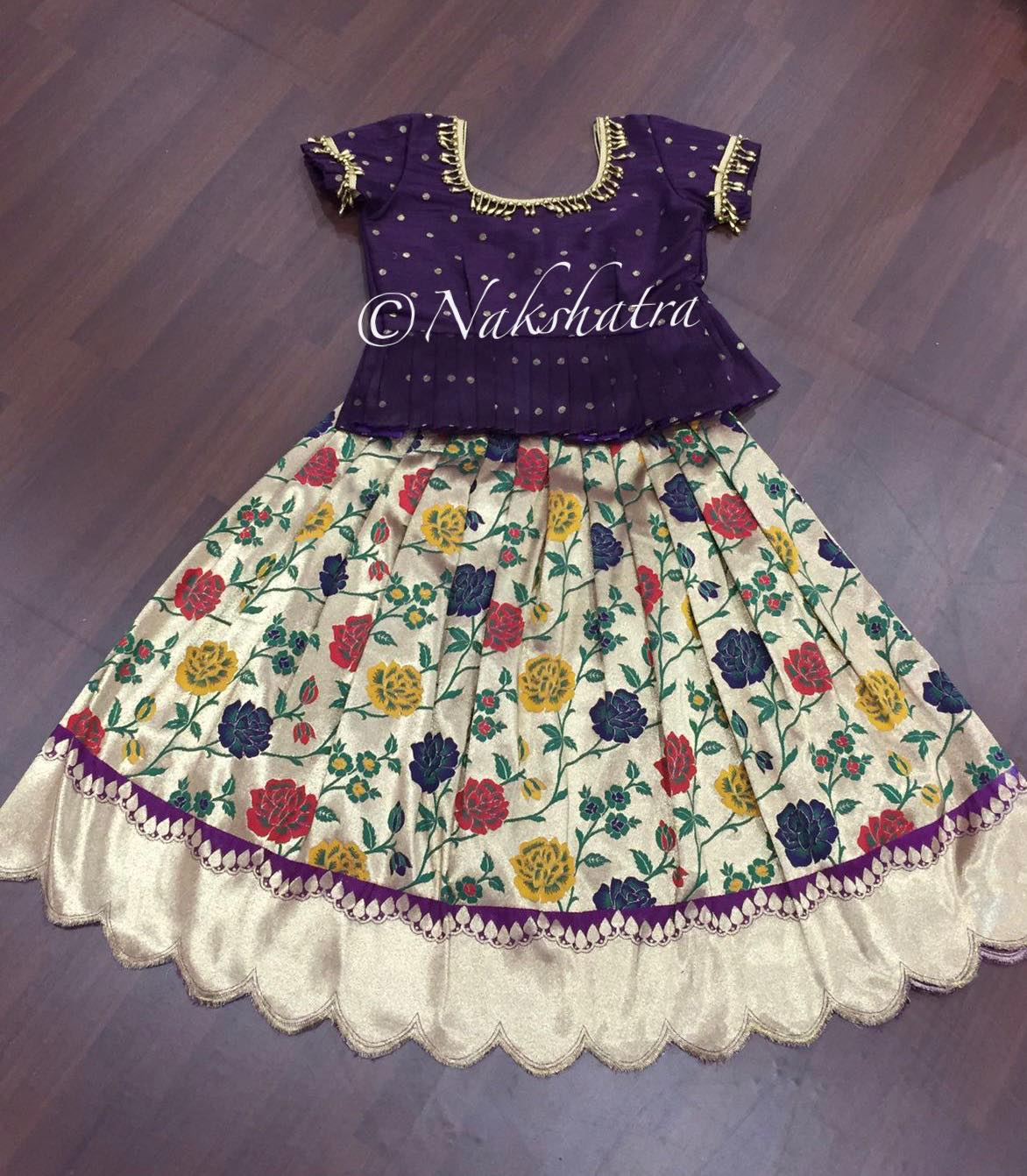 Kids banraasi pythani allover floral design lehanga with scallped edges paired with cute wine color peplum blouse  Shoulder to toe lenght -32-34 inches extendable  Blouse lenght -15  Chest -24-28 extendable 2021-10-04