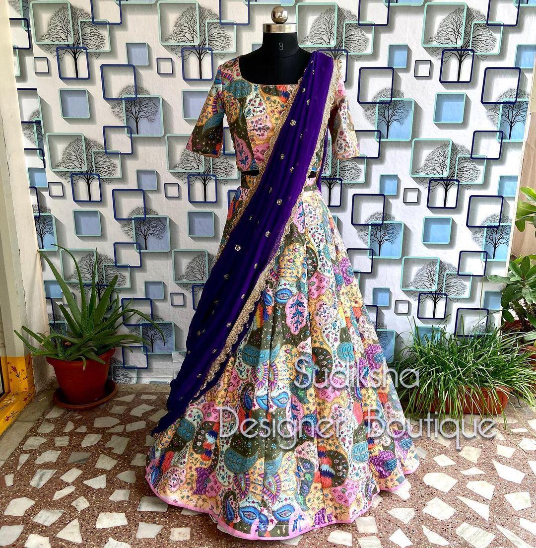 Beautiful multi color bridal lehenga and blouse with deep blue net dupatta. 2021-10-04