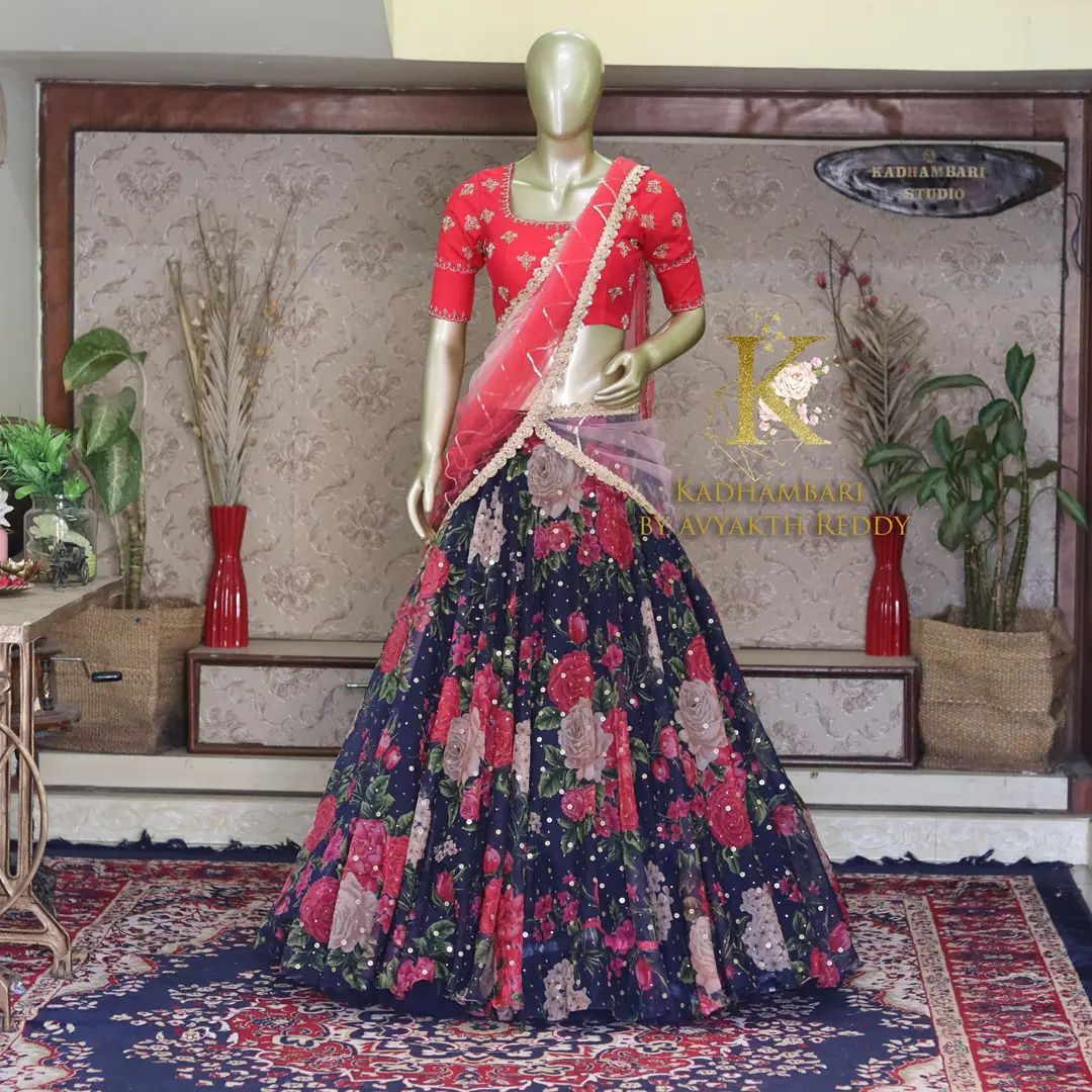 Gorgeous floral lehenga and red blouse with net dupatta. Blouse with maggam work. This outfit is Available @ price : 11800/- 2021-10-04