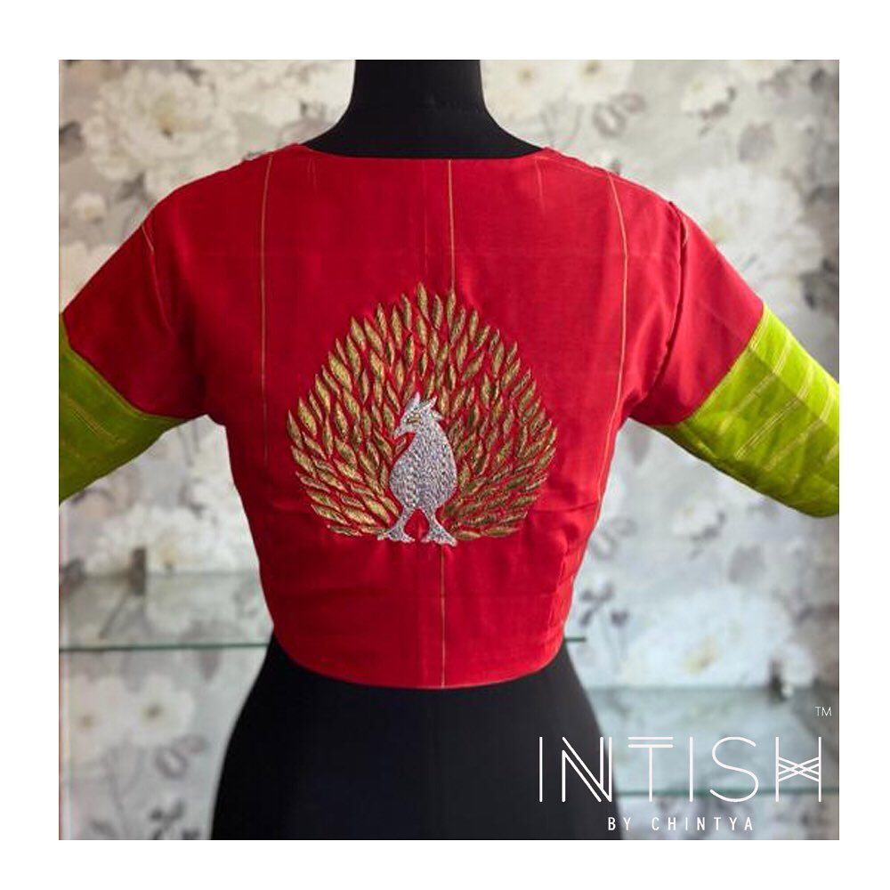Beautiful blouse with peacock hand embroidery thread maggam work.  2021-10-05