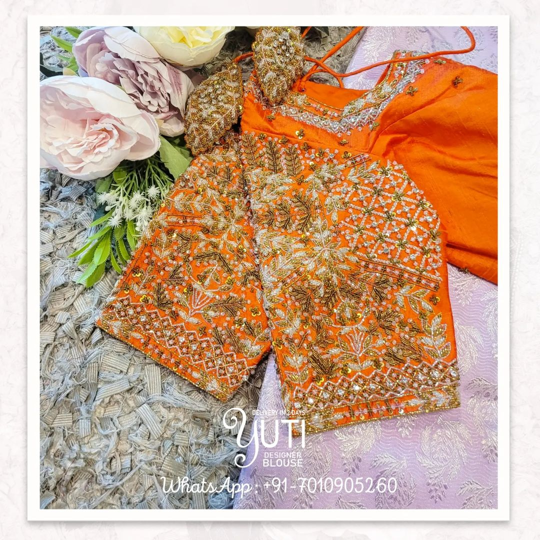 Gorgeous yellow color bridal blouse with bead and stone maggam work. 2021-10-05