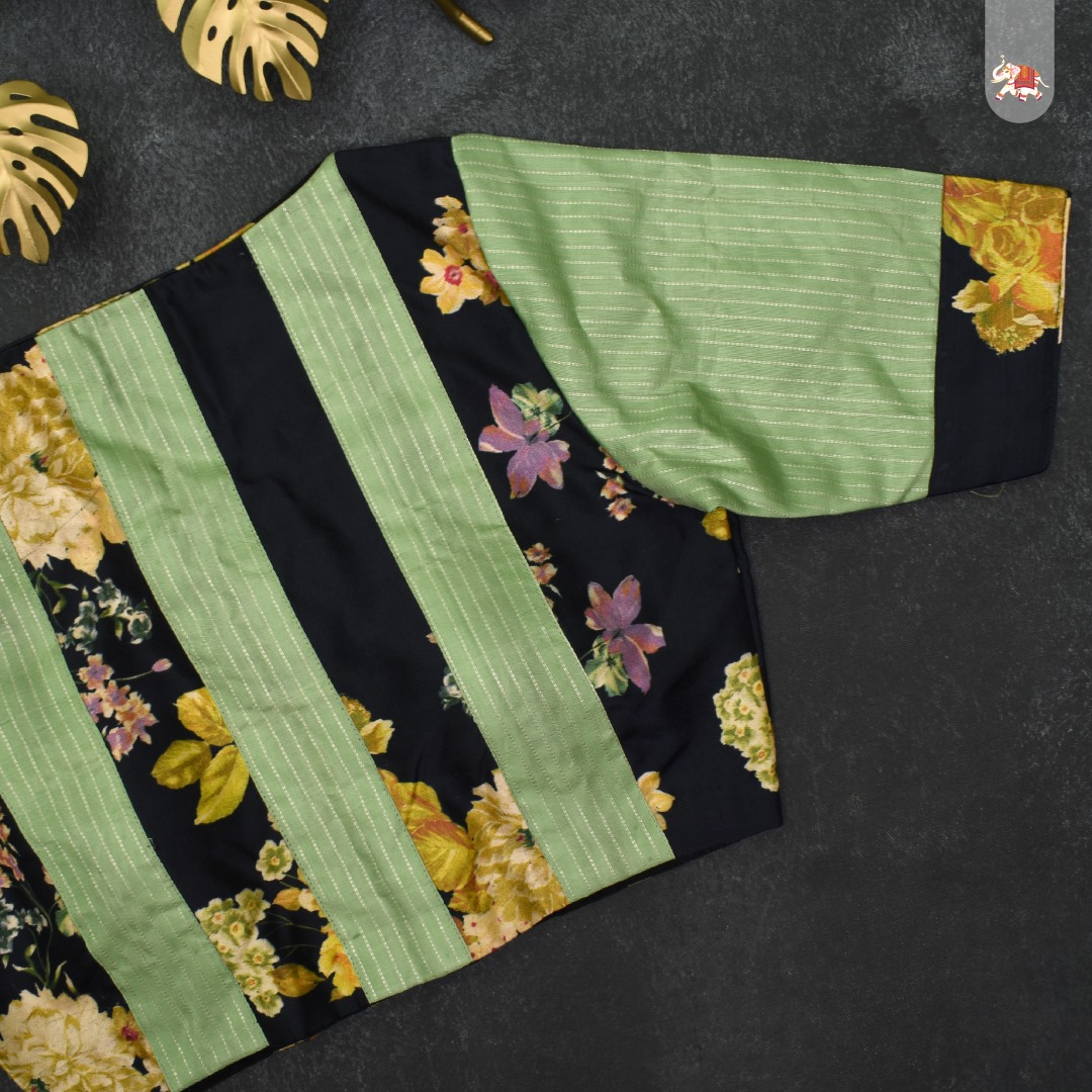 Floral printed black Kanchi silk ready-made designer blouse with apple green Kanchi Silk fabric for the back and sleeves that can be paired with a saree to make you ethnic look stunning! 2021-10-06
