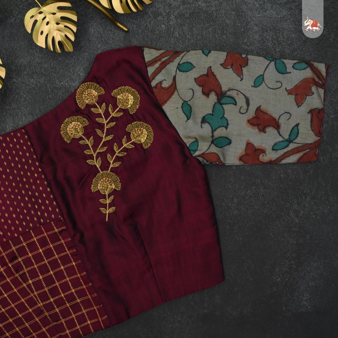 Maroon Kanchi silk ready-made designer blouse with floral zardozi details & & grey pen kalamkari sleeves that can be paired with a saree to make you ethnic look stunning! 2021-10-06