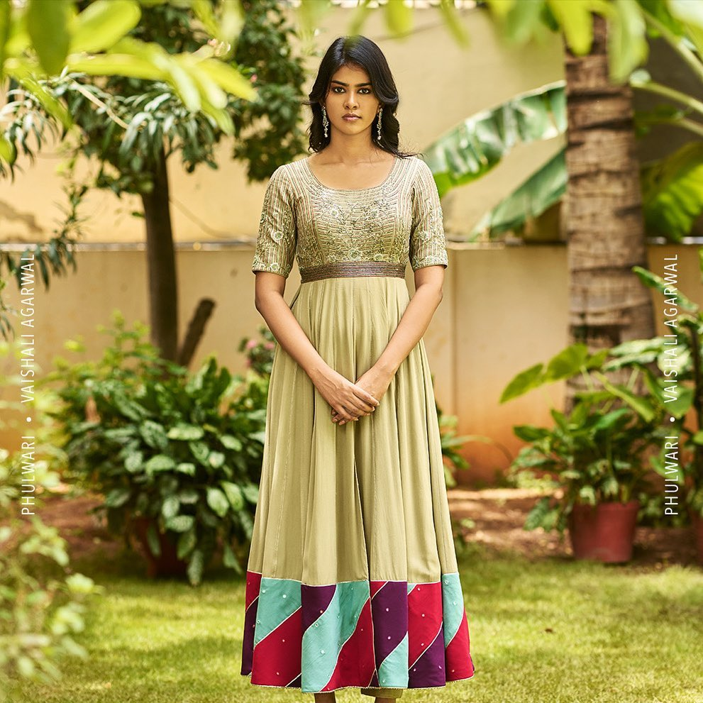 Divya in Rosemary green gown with thread and zardozi embroidery on torso. The silhouette has a broad colour patchwork border giving it a fun look.  To shop  new collection Phulwari DM or Whatsapp  on +91 99083 48333. 2021-10-06