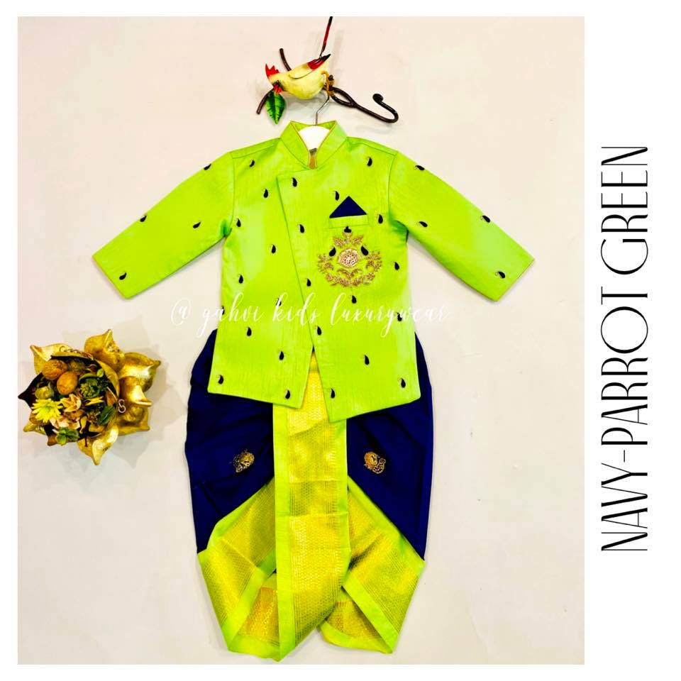 Bright parrot green kids sherwani paired with navy blue dothi in nice kanjeevaram style border . For orders : DM or whatsapp 7893037777( messages only  no calls plz )  2021-10-06