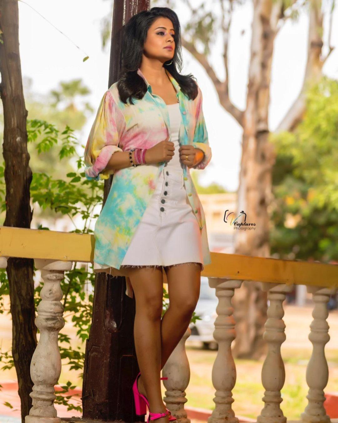 Beautiful actress Priyamani in knee length dress with toe die print long jacket. Shirt dress : Dziine by Deepa. Skirt : Gap. Managed by : Viral mantra. Stylist : Mehek shetty. 2021-10-06