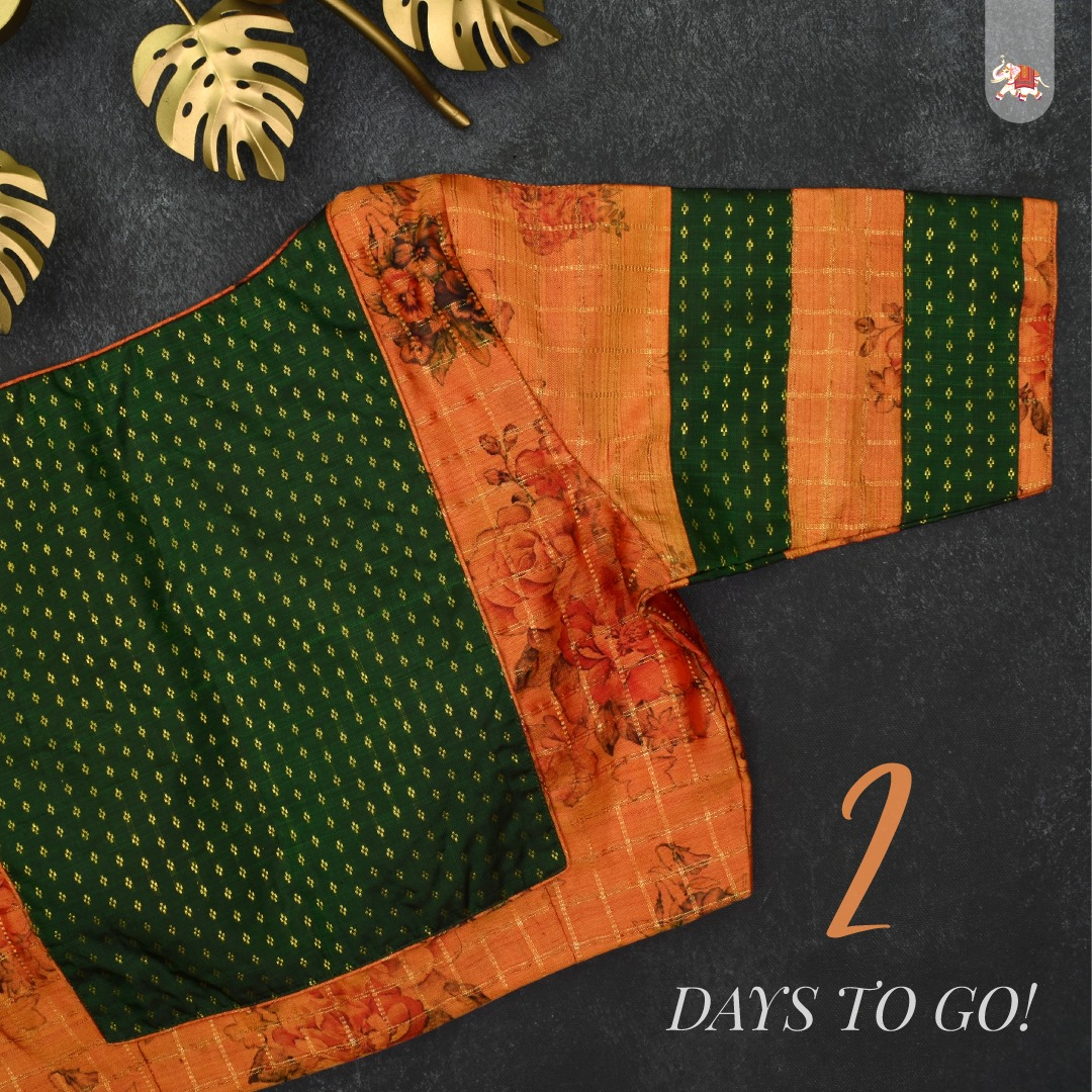 Floral printed orange Kanchi silk ready-made designer blouse with bottle green Kanchi Silk fabric for the back and sleeves that can be paired with a saree to make you ethnic look stunning! 2021-10-07