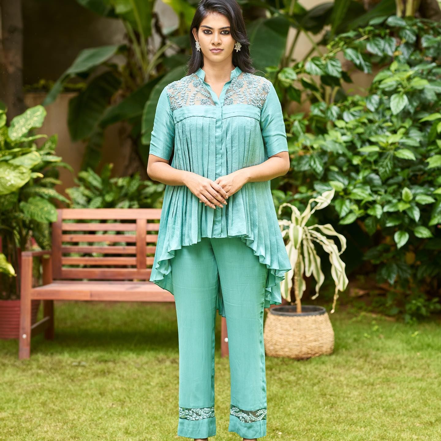 Divya in Skyline blue indowestern set with thread and zardozi embroidery detailing. This new chic silhouette is perfect to wear for mehendis cocktail parties and other wedding festivities.  2021-10-07