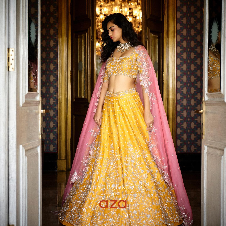 Stunning yellow bridal lehenga and blouse with blush pink net dupatta. Bridal lehenga set with classy hand embroidery work.  2021-10-07