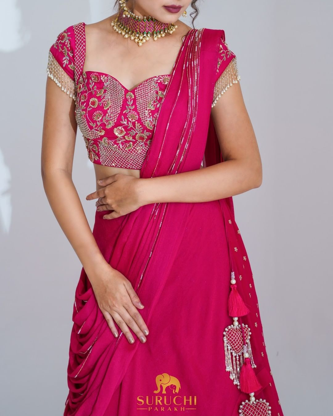 Rani Pink monochromatic lehenga set with golden work details feels like royalty to us. Get your hands on this and try it yourself. 2021-10-07