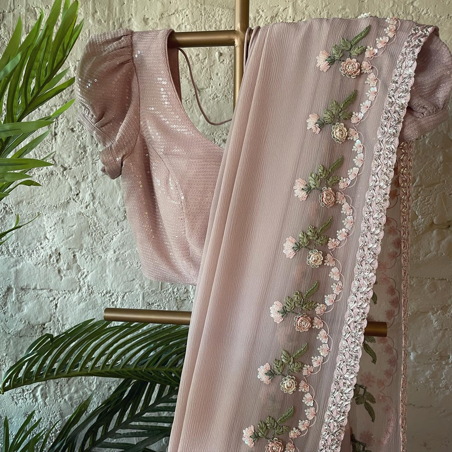 Gorgeous blush pink color saree and puff sleeve blouse with floral hand embroidery work.  2021-10-08
