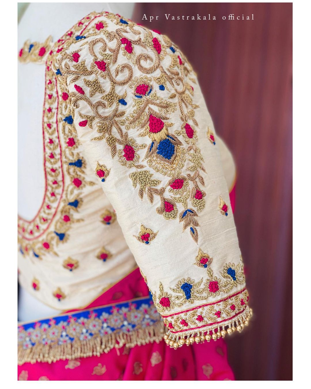 Stunning off white color bridal blouse with floral and creeper hand embroidery silver and multi color thread maggam work.  2021-10-08